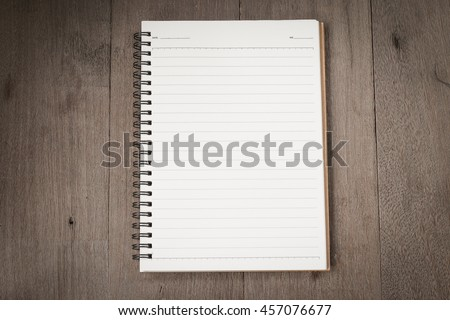 Top view of open book spiral put on old wooden for background. with copy space for write text. - stock photo