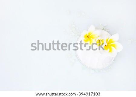 Top view of organic cream with frangipani flower - stock photo