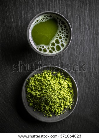 Top view of organic green matcha tea in a bowl and matcha powder - stock photo
