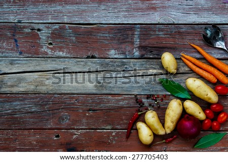 Top view of organic vegetables on rustic wooden table. Food background. Healthy food from garden. - stock photo