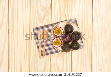 Top view of passion fruit on wood table - stock photo