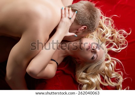 Top view of passionate couple making love - stock photo