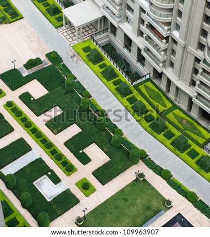 top view of path in garden, and surrounded by green plants. - stock photo