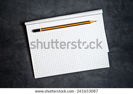 Top View of Pencil And Blank Notepad Page as Copy Space for Text Message - stock photo