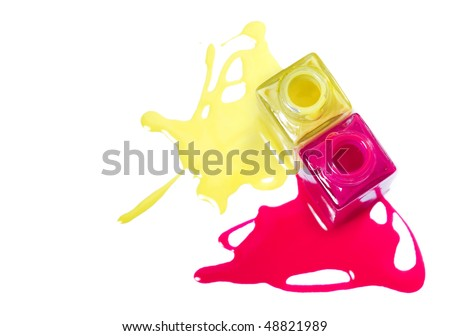 Top view of pink and yellow matte nail polish on white background. - stock photo