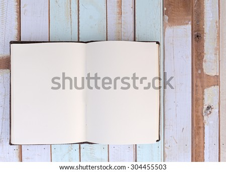 Top view of recycle notebook on retro wooden board - stock photo