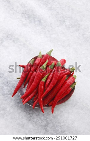 top view  of Red chili paddy in the small plate - stock photo
