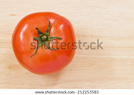 top view of red tomatoes on wooden - stock photo