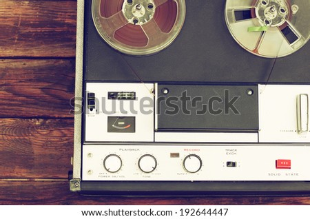 top view of reel to reel vintage recorder. filtered image - stock photo