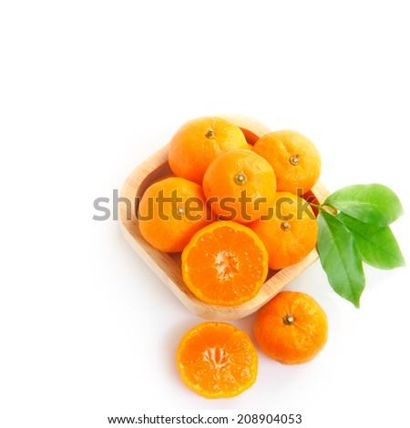 Top view of ripe orange fruits isolated on white background - stock photo