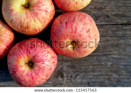 Top view of ripe red apples on a wooden plank - stock photo