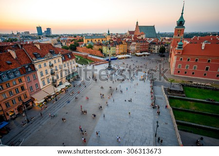 Top view of Royal castle and old town crowded with people in Warsaw - stock photo