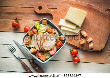 top view of salad cesar with chiken on white wood table - stock photo