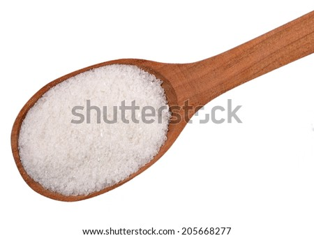 Top view of salt in a wooden spoon on a white background - stock photo