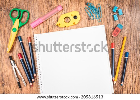 Top view of school accessories on a desk with copy space - stock photo