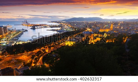 Top  view of seaside part of Malaga with Port from castle in  evening time. Spain - stock photo