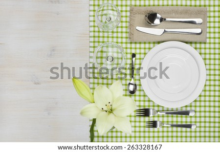 Top view of served wooden restaurant table with copy space - stock photo