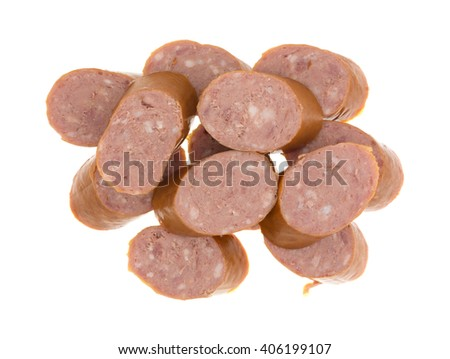 Top view of several slices of reduced calorie kielbasa sausage isolated on a white background. - stock photo