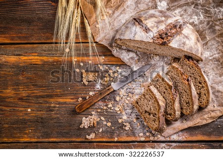 Top view of sliced artisan bread on vintage wooden surface - stock photo