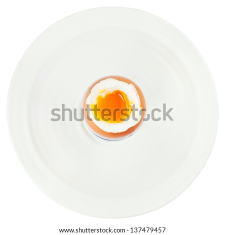 top view of soft boiled egg in egg cup on white plate isolated on white - stock photo