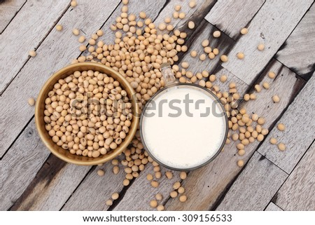 top view of soy milk and soy beans with wood background - stock photo