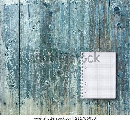 Top view of squared sheet of notebook on rustic blue wooden table. Copy space - stock photo