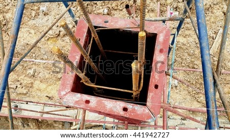 Top view of steel formwork for reinforced concrete column with reinforcement steel bars in construction site - stock photo