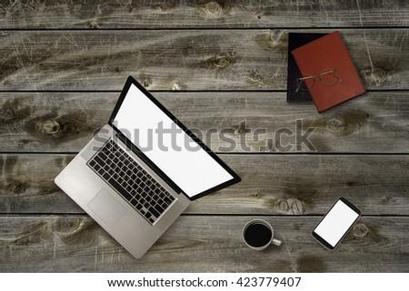 Top view of stuff office desktop - stock photo