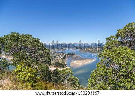 Top view of Tairua river from Paku mountain, the Coromandel peninsula, New Zealand. - stock photo