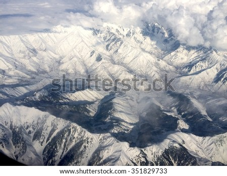 Top view of the highest mountain. Himalaya is covered with snow. - stock photo