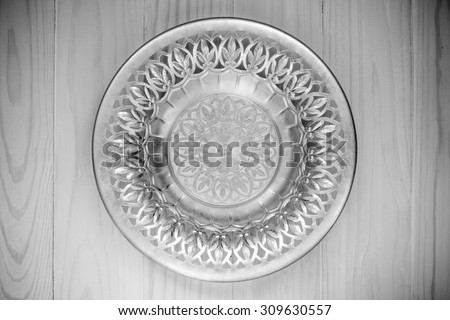Top view of the silver plate. Black and white photo - stock photo