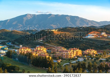 Top view of the sunrise over the village of La Cala de Mijas. Andalusia. Spain - stock photo