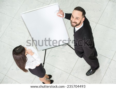 Top view of two business people at work. - stock photo