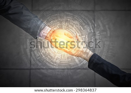 Top view of two businesswpeople shaking hands - stock photo
