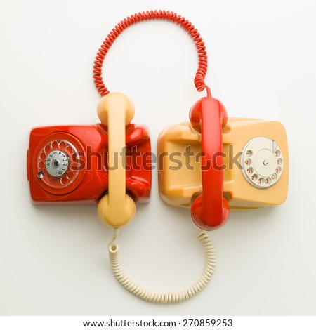 top view of two vintage phones connected with each other by handsets - stock photo