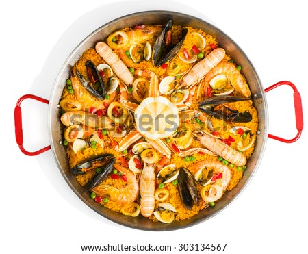 Top view of typical spanish seafood paella in traditional pan isolated on white background - stock photo