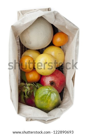 Top view of variety of fruits in sack over white background - stock photo