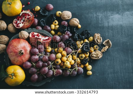 top view of various fruits on dark blue colored table - stock photo