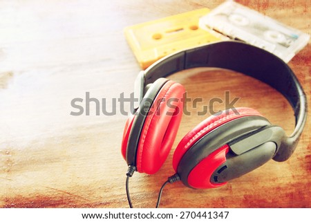 top view of vintage headphones and cassettes  - stock photo