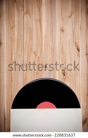 top view of vinyl record over wooden table - stock photo