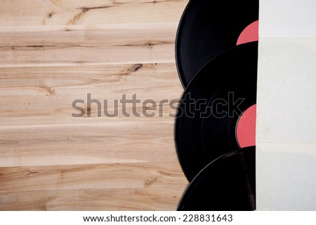 top view of vinyl records over wooden table - stock photo