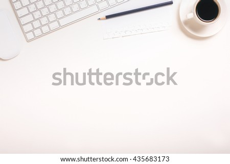 Top view of white office desktop with keyboard, coffee cup, computer mouse and pencil. Mock up - stock photo