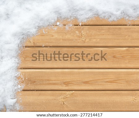 Top view of wooden surface covered with snow - stock photo