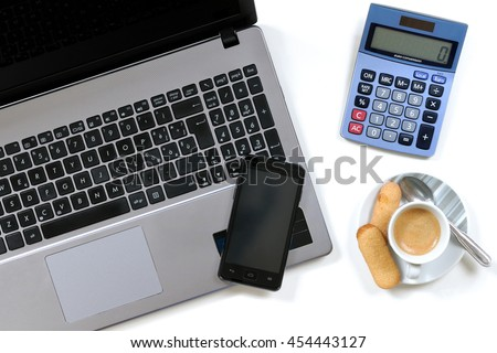 Top view of work items with coffee and cookies placed on the desk in a modern office - stock photo