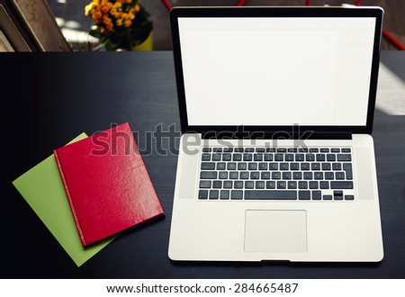 Top view of workplace with open laptop and colorful notebooks, computer with blank copy space screen for your information or content, modern table at open window in home interior, distance work - stock photo