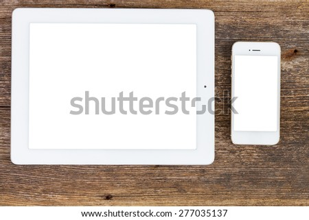 Top view office workplace with tablet  and phone on wooden background with copy space on screens - stock photo