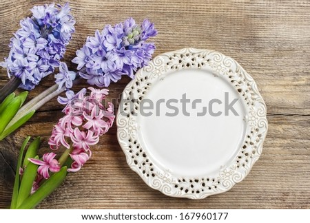 Top view on empty plate on wooden table  - stock photo