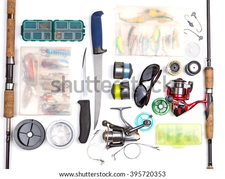 top view on fishing tackles with white background. mokap for outdoor adventure business - stock photo