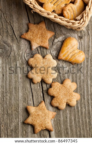 Top view on homemade sugar cookies on old wooden table - stock photo