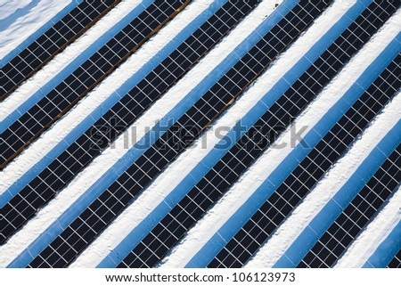Top view on large solar panels in photovoltaic park - stock photo